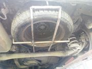 Крепление запасного колеса Opel Zafira B